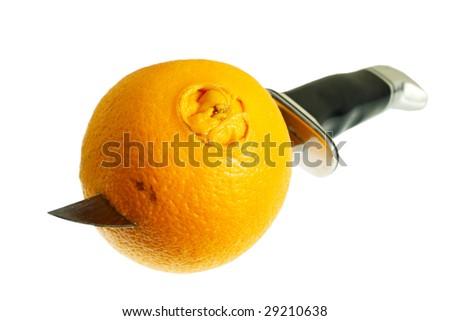 an orange pierced by knife