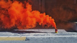 An orange smoke signal was tested during emergency drill training emitting an orange smoke. Smoke signal are a tool to provide marking for rescue operation and indicate wind direction during emergency