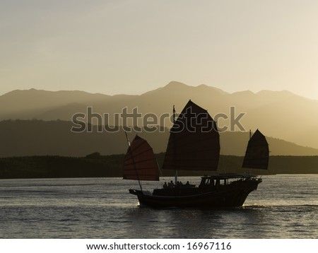 An oriental sunset cruise coming back into port.