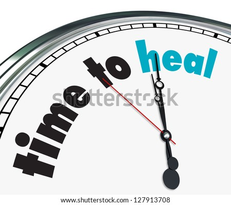 An ornate clock with the words Time to Heal on its face - stock photo