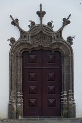 An ornately carved door and surround on a church in Ponta Delgada, Azores, Portugal