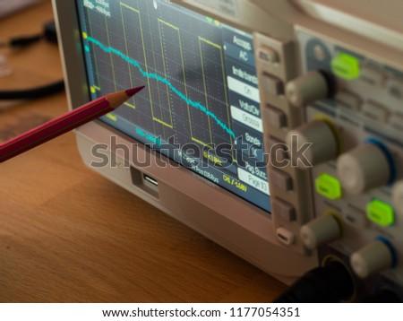 An oscilloscope with a pencil