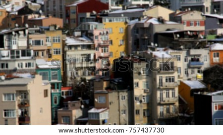 An out of focus view on colorful, but chaotic apartment buildings, in the metropolis of Istanbul, Turkey. All the windows have random clutter in front of them. Should be used as a background only. #757437730