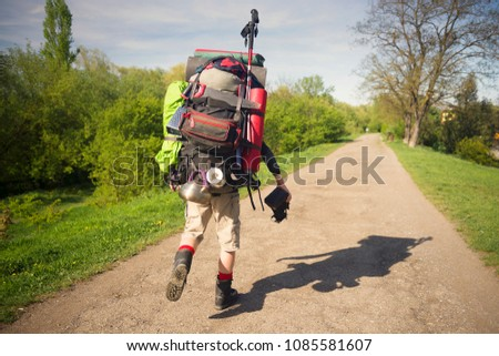 An outdated way of traveling is a huge uncomfortable backpack stuffed with cumbersome heavy equipment. Ancient camera- as a symbol of old-fashioned things