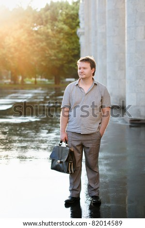 An Outdoor Portrait of the Man during Sunset and after the Rain
