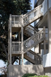 An outdoor staircase at an apartment building.