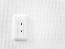 An outlet on a white wall. A Japanese style outlet.