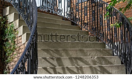 An outside staircase, leading up to a balcony. #1248206353