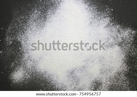 black table top view. an overhead photo of wheat white flour sprinkled on the black wooden table. top view table