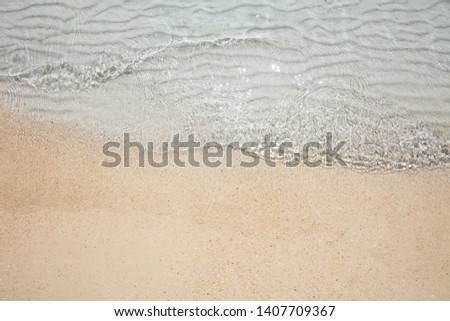 An Overhead View Of Shiny Crystal Sea Water On Sand At Beach #1407709367