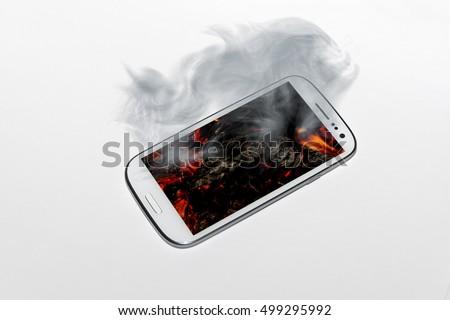 An overheated smartphone smoking #499295992