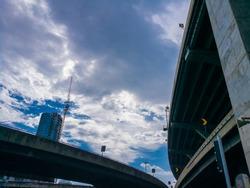 An overpass bridge light standard from below against a blue sky background. highway bridge, Highway Bridge with sky background
