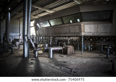 An overview of a operation hall at an abandoned power station, an amazing control room looks over the complete area.