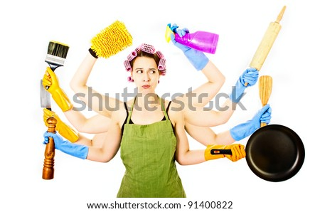 An overworked very busy multitasking housewife under stress