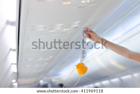 an oxygen mask on the plane.selective focus, Soft focus . #411969118