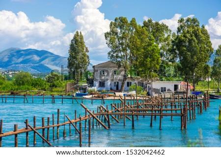 An oyster farm on Lake Butrint near Ksamil, Albania on a beautiful sunny day