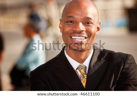 An portrait of an African American Business Man in an outdoor setting - stock photo