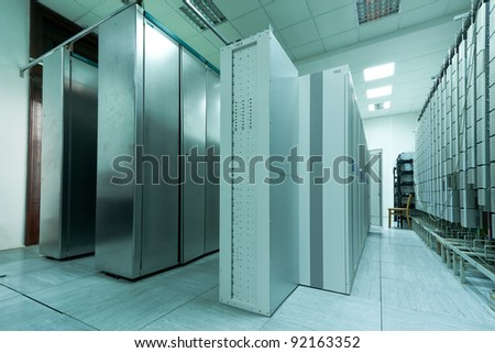An row of racks in a commercial data center securely housing computers and servers.