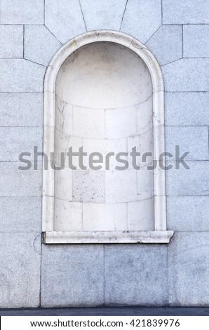 an semicircular niche empty in a granite wall