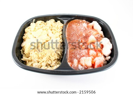 An unappetizing looking frozen tv dinner shot on white