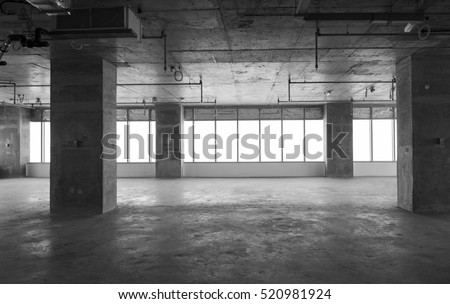An under construction office building interior. A huge hall with panoramic windows being constructed. stock photo