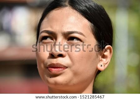 An Unemotional Beautiful Filipina Female #1521285467
