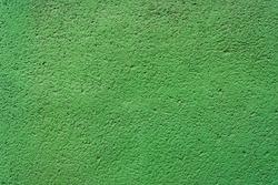 An uneven green woodchip texture background