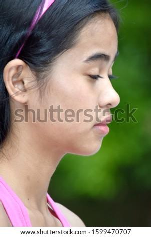 An Unhappy Cute Minority Girl