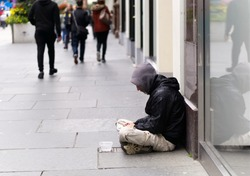 An unidentified homeless man begging on city street in Glasgow, Scotland.