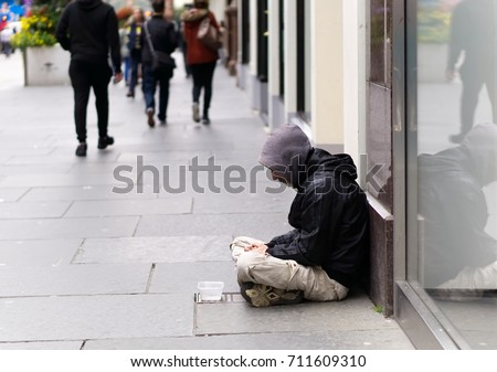 Stock Photo An unidentified homeless man begging on city street in Glasgow, Scotland.