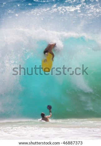 An unidentified young man participating in Big Wave Surfing using mini-board, Sunset Beach, Oahu, Hawaii, on February 15, 2009.