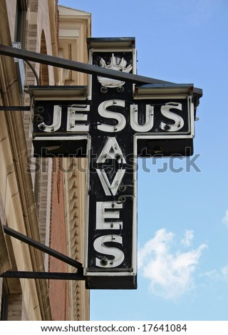 An unlit neon sign reading Jesus Saves