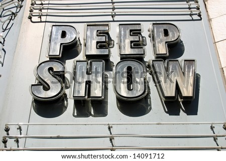 An unlit neon sign that reads Peep Show in Montreal, Quebec