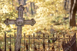 an unnamed burial cross in an abandoned cemetery, old cemetery, grave with a vintage cross, fall season