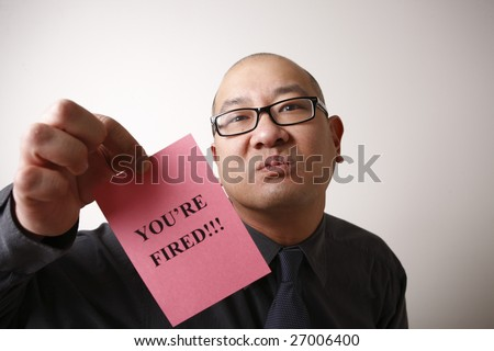 An unpleasant employer handing out a pink slip.