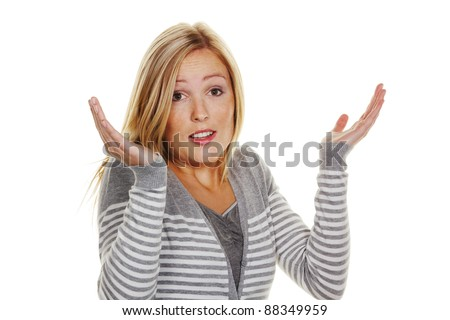 an unsuspecting woman shrugs. shrug of helplessness and - stock photo
