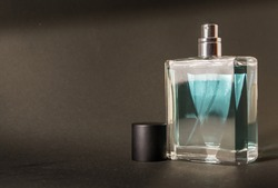 An unused fresh bottle of aftershave with a black lid