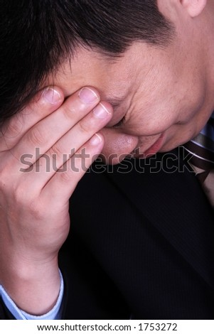 An upset chinese business man. - stock photo