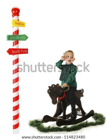 An upset preschooler on a rocking horse pointing towards a pole with directions for getting to Santa's home.  On a white background with plenty of space for your text.