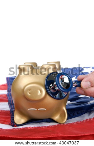 An upside down, nearly dead piggy bank on an American flag is being examined for signs of economic and financial life.  Image can be good for health care, economic or financial inferences.