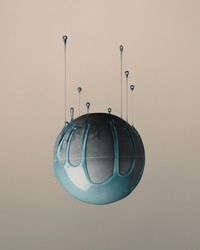 An upside-down of a gray ball with blue paint dripping upward isolated on pink background
