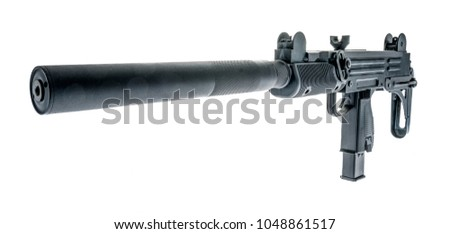 An UZI with a silencer and it's stock folded on an isolated background. #1048861517