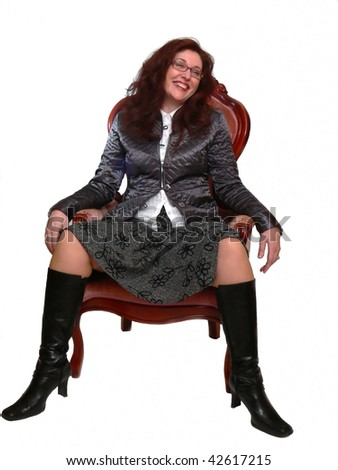 An very happy business lady sitting in an armchair and has fun with her colleges.
