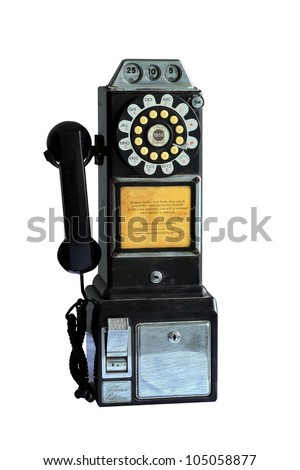 An vintage pay phone isolated on white background with clipping path