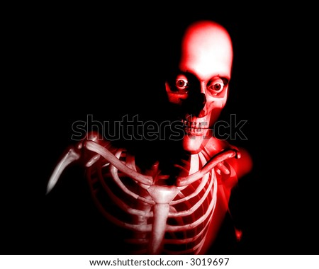 An x ray image of a some man in which you can see the Skelton under the skin.