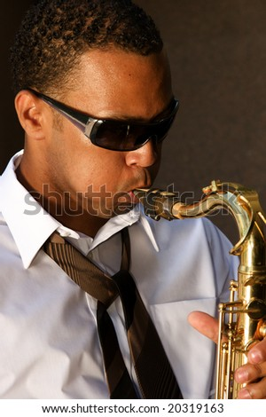 An young and trendy African-American sax musician - stock photo