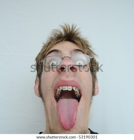 An young man with a huge mouth and tongue sticking out - stock photo