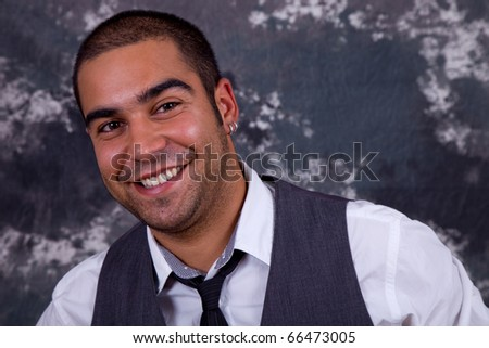 an young pensive business man close up portrait - stock photo
