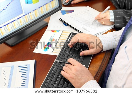 Analizing Data in the Office. Hands on the Keyboard and Financial Data and Charts in the Office