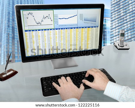 Analizing Data on Computer Male Hands on the Keyboard in Front of Computer Screen with Financial Data and Charts